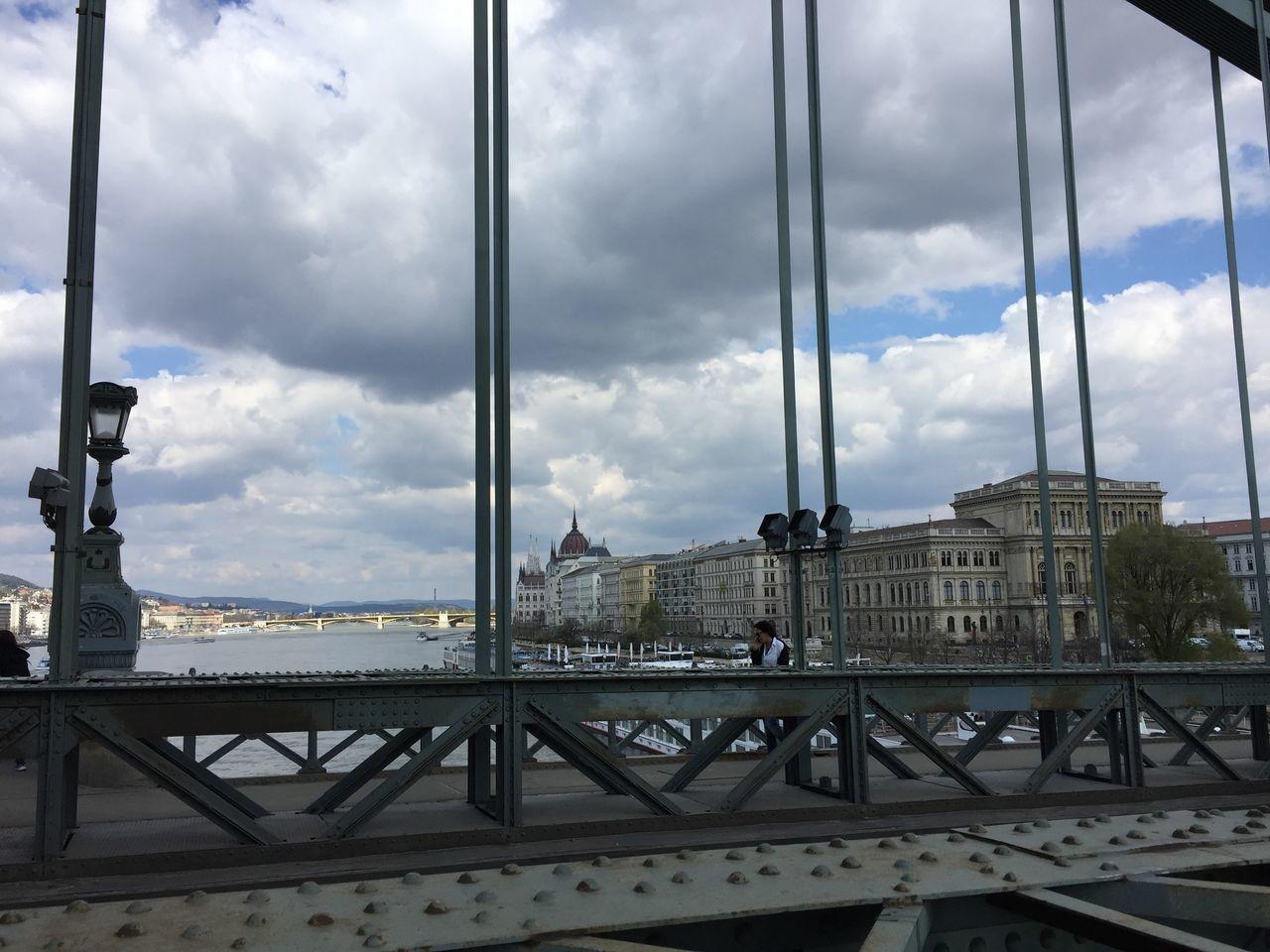 cloud - sky, sky, architecture, railing, built structure, bridge - man made structure, day, city, building exterior, travel destinations, indoors, cityscape, no people