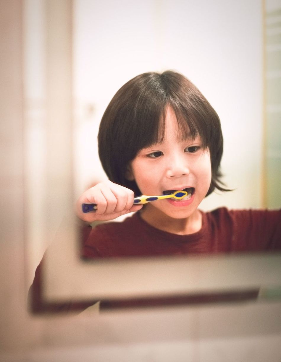 Brushing My Teeth Toothpaste One Person Holding Child Childhood Bangs One Girl Only Portrait Headshot Children Only Indoors  People Day Human Body Part Reflection