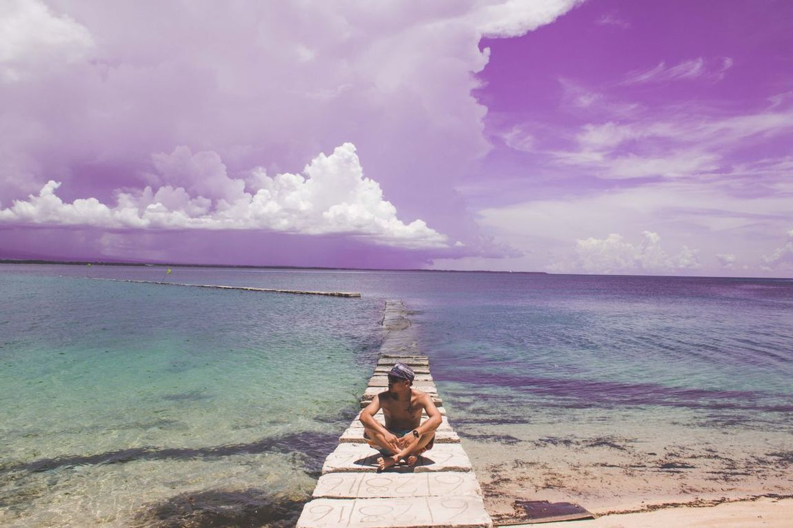 Sea Sky Water Horizon Over Water Cloud - Sky Beauty In Nature Nature Tranquil Scene Beach Scenics Real People Leisure Activity Idyllic Outdoors Full Length Young Adult Vacations Sitting Tranquility Lakawonisland Philippines ASIA Lakawon Island Negros Occidental First Eyeem Photo
