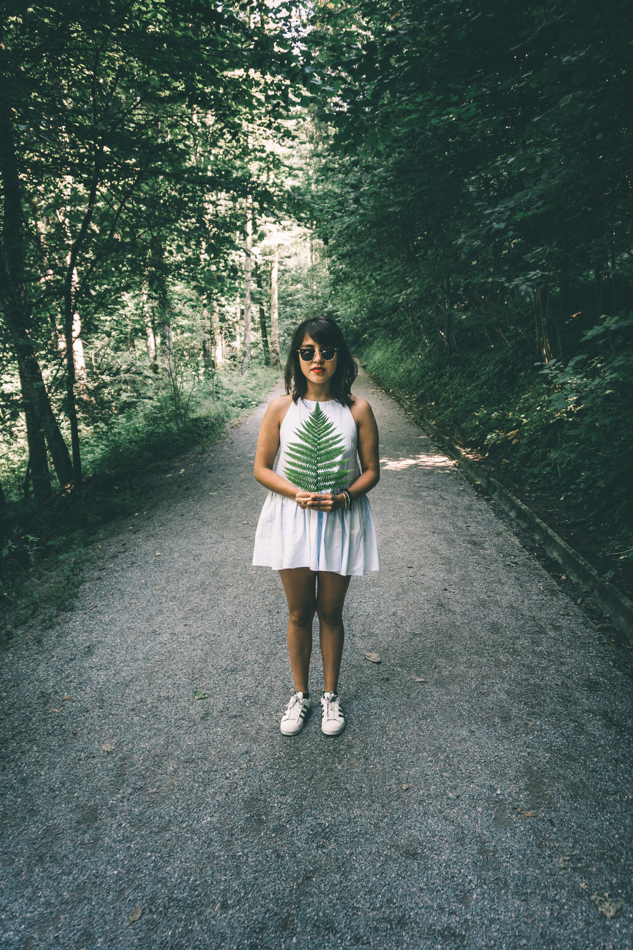 Girl in white dress standing in the forest under green trees Beauty Beauty In Nature Cute Cute Girl Fashion Fern Folk Forest Girl Girl Power Hipstamatic Leaf Looking At Camera Lovely Model Modeling Nature One Person Portrait Pure Purity Style White Dress Woods Young Adult The Portraitist - 2017 EyeEm Awards