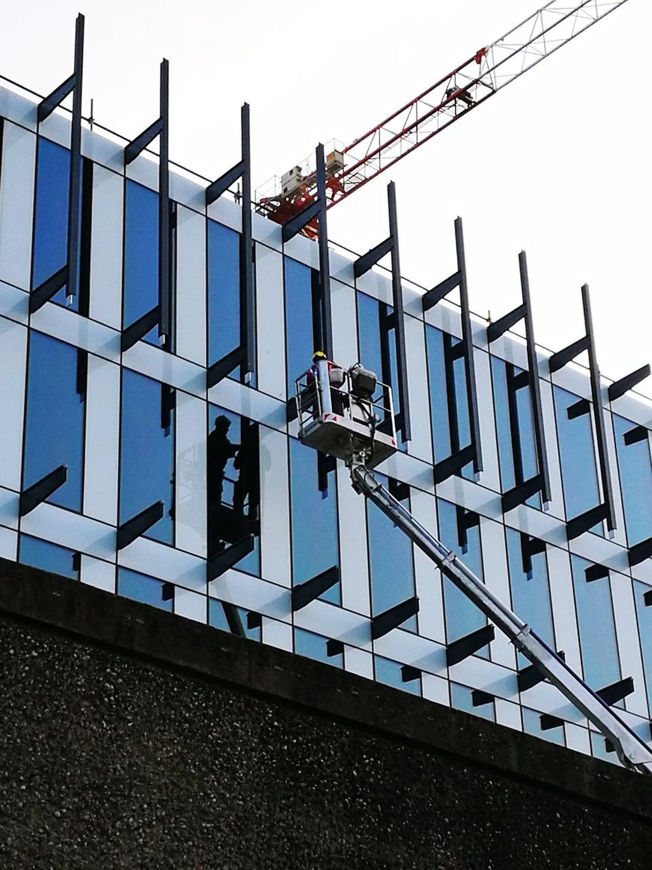 Building Trieste, Low Angle View Business Finance And Industry Manual Worker Day Sky Outdoors People Façade Architecture Building Exterior Building Reflections Pattern Colorphotography Urbanphotography Streetphotography
