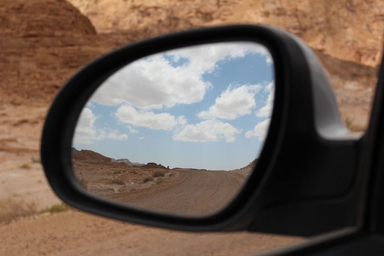 Desert in the car mirror Arid Arid Climate Arid Climate, Arid Landscape Beauty In Nature Brown Hair Car Cloud - Sky Day Desert Israel Landscape Mirror Nature No People Outdoors Reflection Road Trip Side-view Mirror Sky Timna Timnapark Travel Vehicle Mirror Vehicle Part EyeEmNewHere