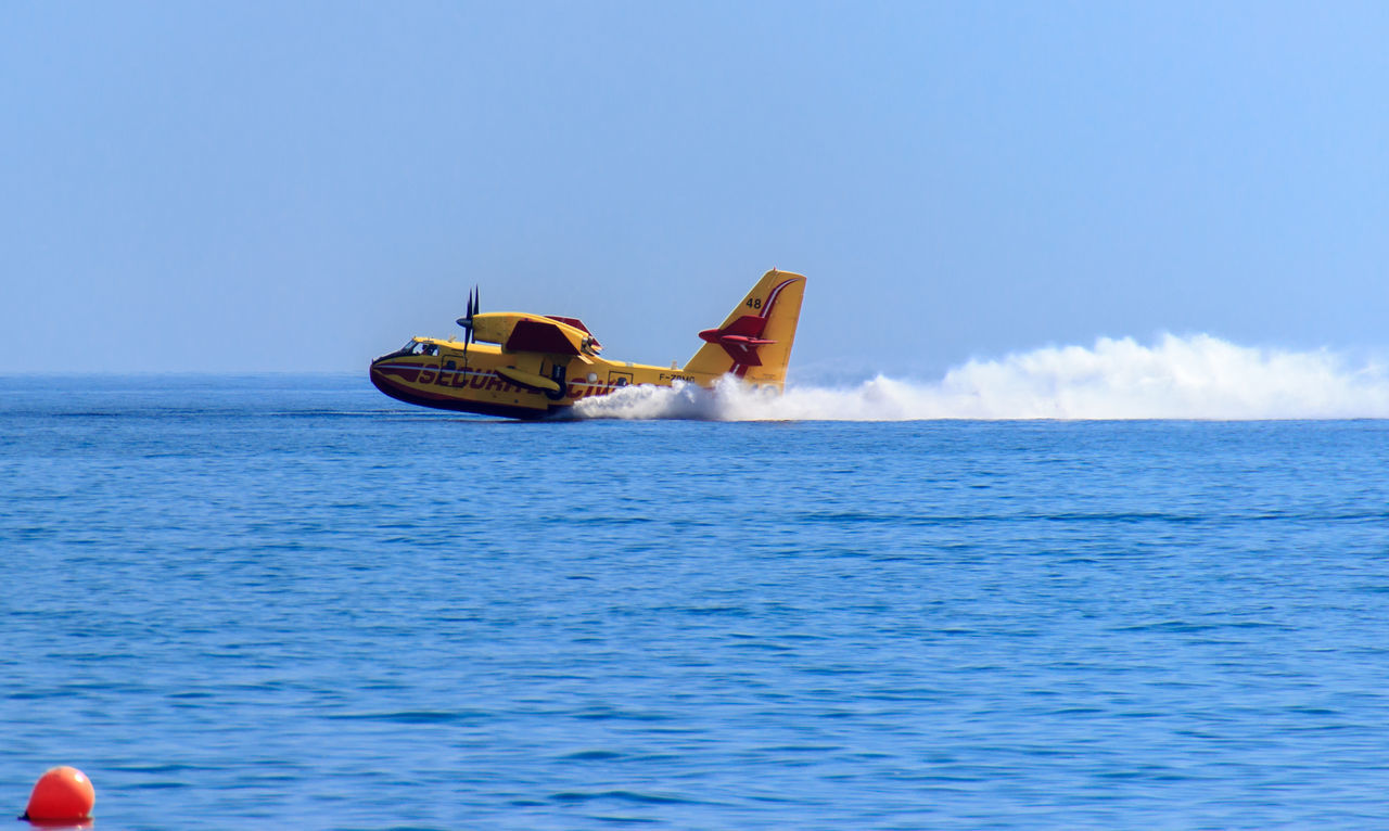 Beautiful stock photos of feuer, sea, sky, nautical vessel, blue