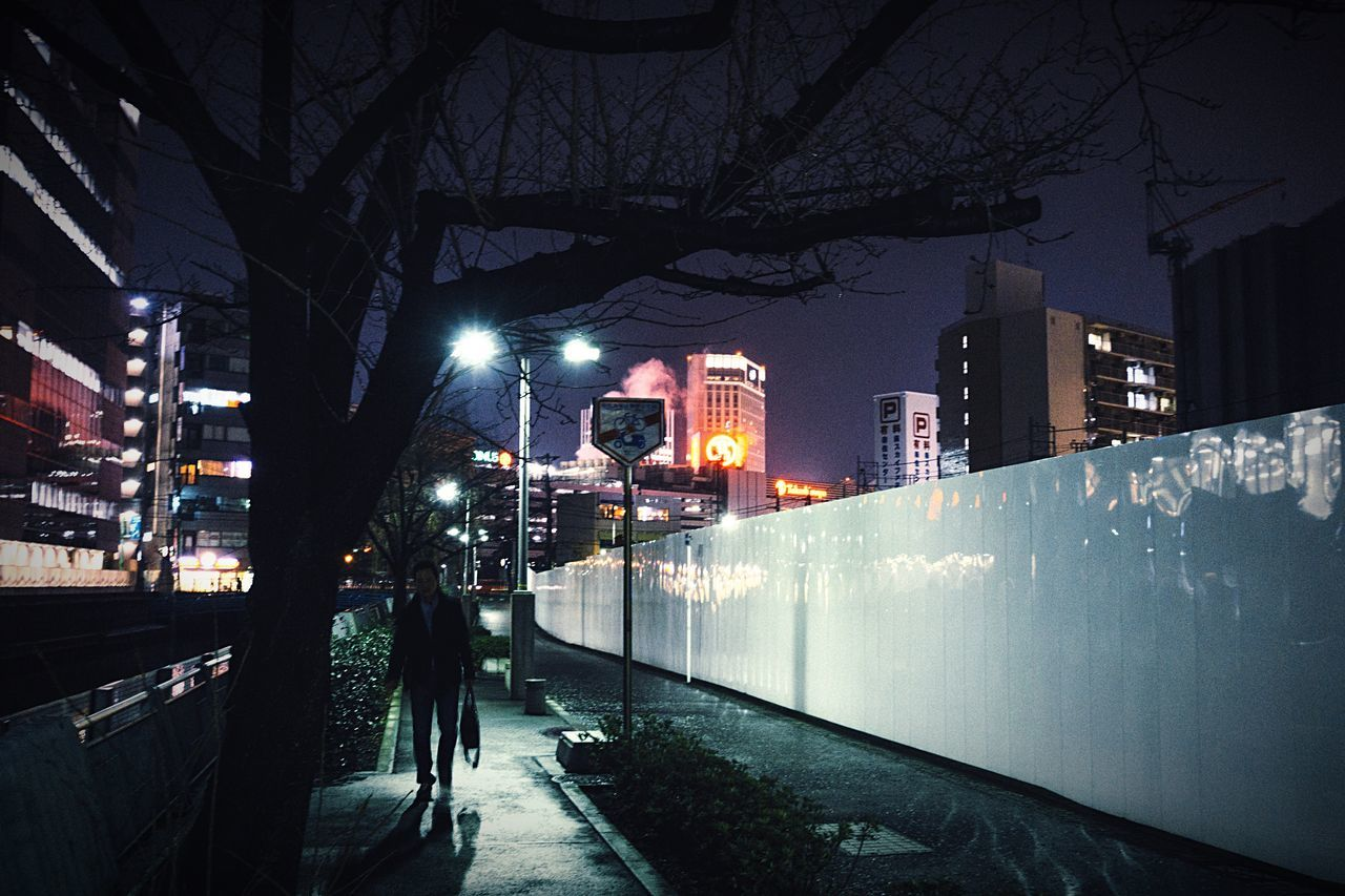 The City Light Night Lights Nightphotography City Life City City Street No People One Person Only Walking Illuminated Lighting Equipment Building Exterior Dark Sky After The Rain Reflection Atomosphere Night City From My Point Of View Yokohama Japan Yokohama, Japan February February 2017