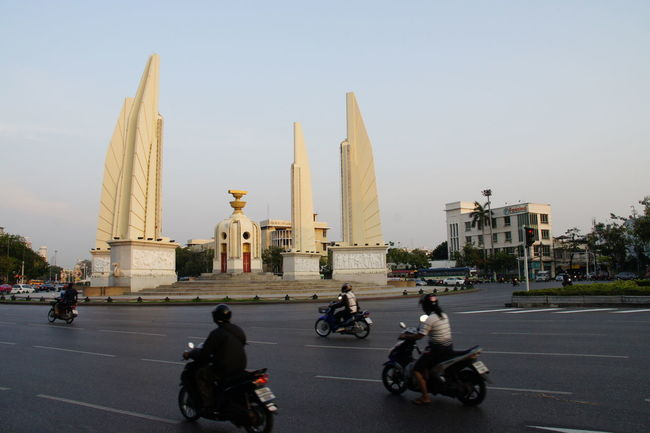 Architecture Bangkok Thailand Building Exterior Built Structure Capital Cities  City City Life Clear Sky Column Democracy Monument Famous Place History International Landmark Monument Outdoors Religion Tall Tall - High Tourism Tower
