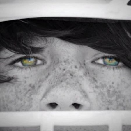 Edited close up of those beautiful eyes he gets from his mom and those cute freckles that he hates!
