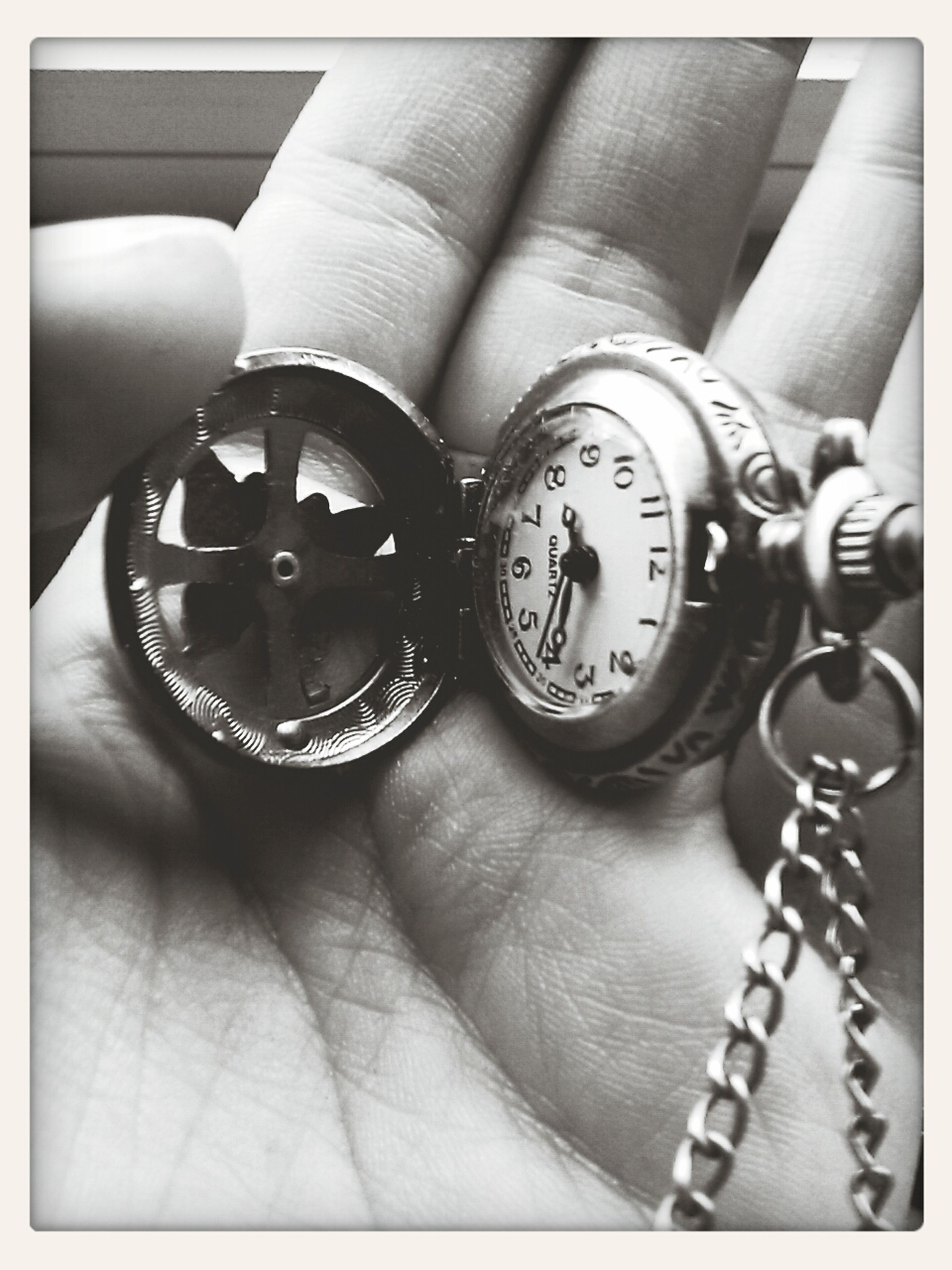 person, indoors, close-up, part of, time, technology, holding, accuracy, number, transfer print, clock, cropped, old-fashioned, photography themes, metal, connection, human finger