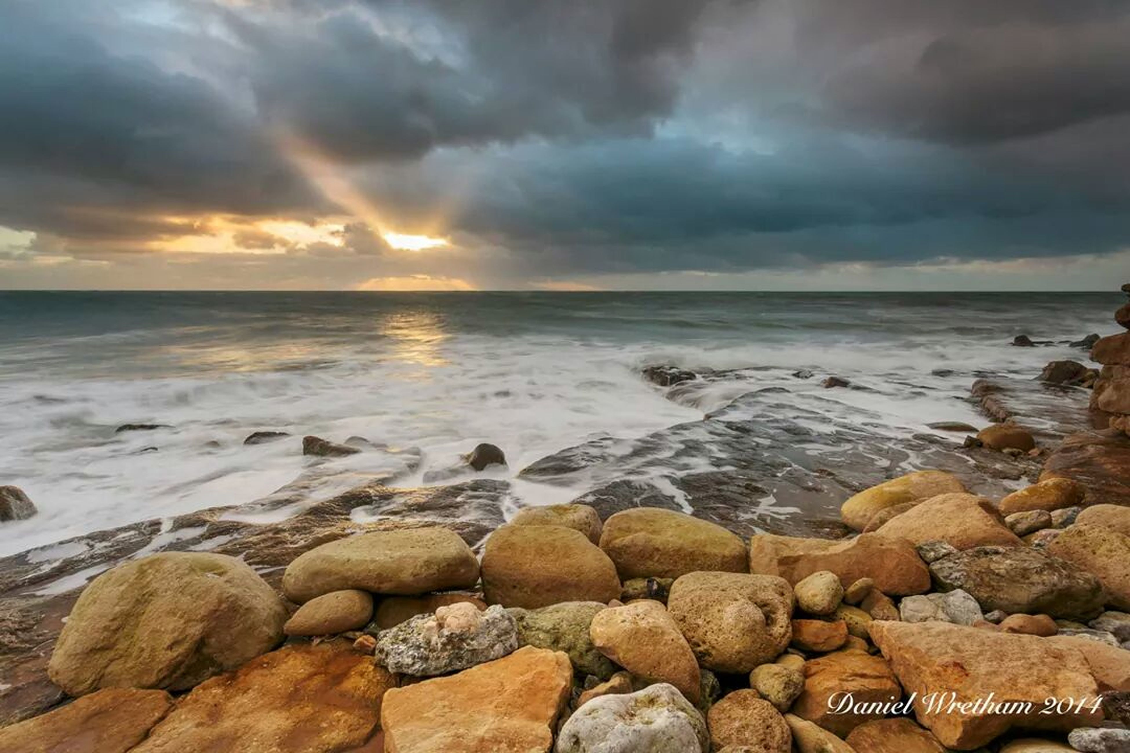 water, sky, sea, horizon over water, cloud - sky, scenics, beauty in nature, tranquil scene, tranquility, sunset, beach, cloudy, nature, shore, rock - object, weather, idyllic, cloud, stone - object, overcast