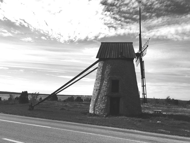 Road Sky Empty Cloud Pole Outdoors Tranquil Scene Countryside Day Power Line  Cloud - Sky Scenics Tranquility Country Road Solitude The Way Forward Non-urban Scene No People Power Supply My Photography Faro Sweden Windmill Rustic Old Buildings