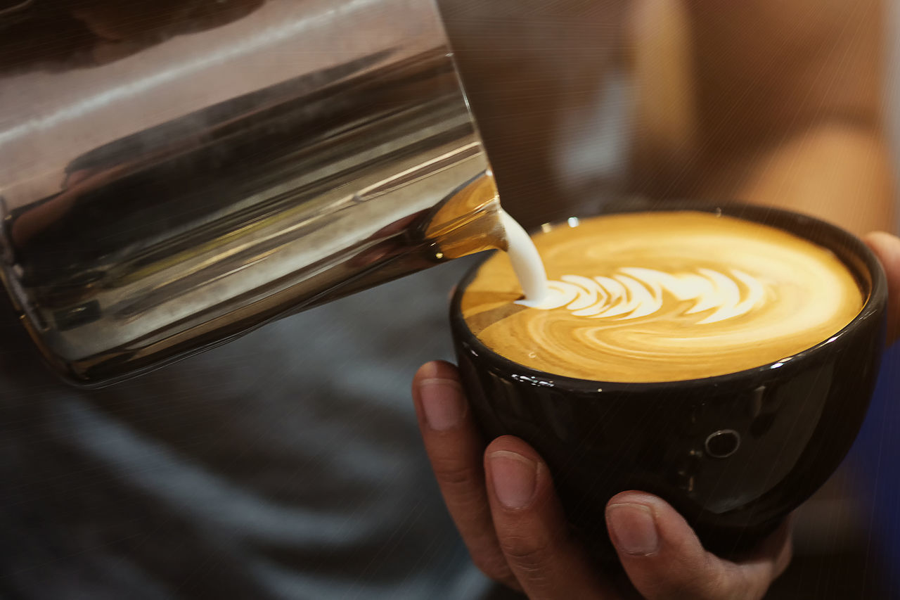 Barista is making latte art. Barista Cafe Close-up Coffee - Drink Coffee Cup Drink Hand Holding Human Hand Latte Art Latte Coffee Milke Pouring