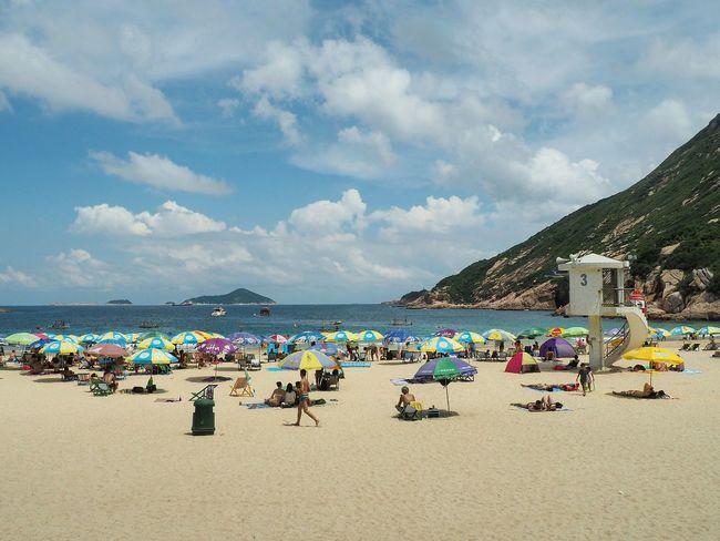 Beach Sea Sand Sky Summer Day Outdoors Vacations People Hong Kong Blue Sky Beach Umbrella Clouds Sandy Beach