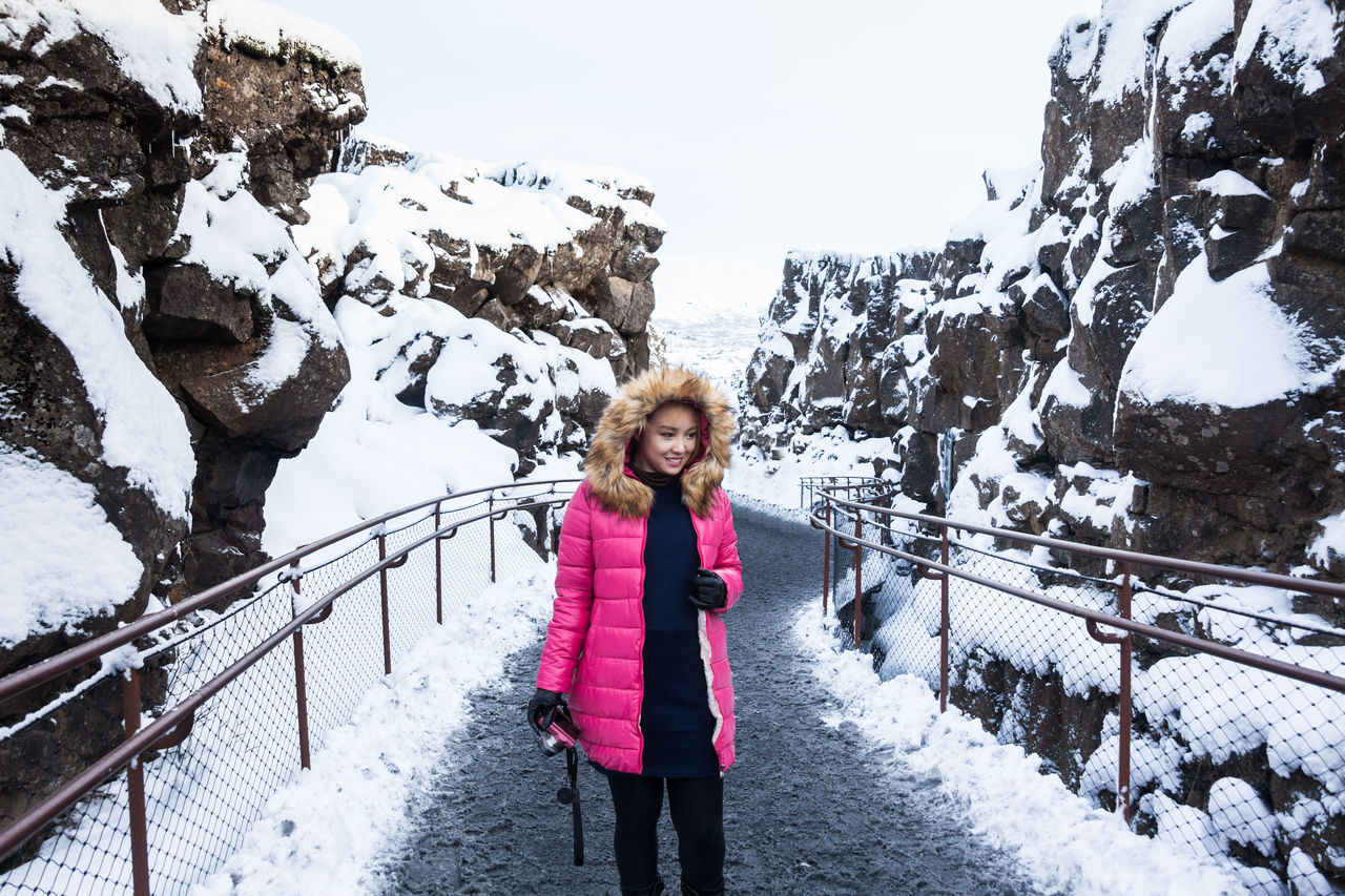 Thingvellir National Park or better known as Iceland pingvellir National Park during winter Beauty In Nature Cold Temperature Day Front View Full Length Happiness Leisure Activity Lifestyles Looking At Camera Mountain Nature One Person Outdoors Real People Snow Thingvellir Thingvellir National Park Thingvellir National Park Iceland Warm Clothing Weather Winter þingvellir Þingvellir National Park Þingvellir National Park Iceland Snow Winter Þingvellir National Park, Iceland