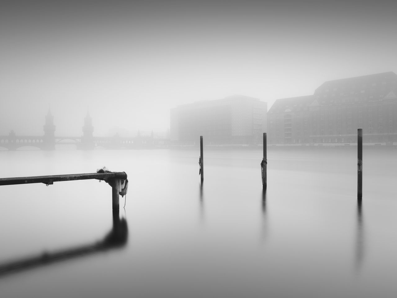 Pier at the Oberbaumbridge in Berlin Berlin Berlin Friedrichshain Berlin Kreuzberg Berlinstagram Black And White City City Cityscape Day Fine Art Fineart_photobw Fog Foggy Day Foggy Weather Longexposure Nature No People Oberbaumbridge Oberbaumbrücke Outdoors Philipp Dase Sky Travel Destinations Urban Icon Water