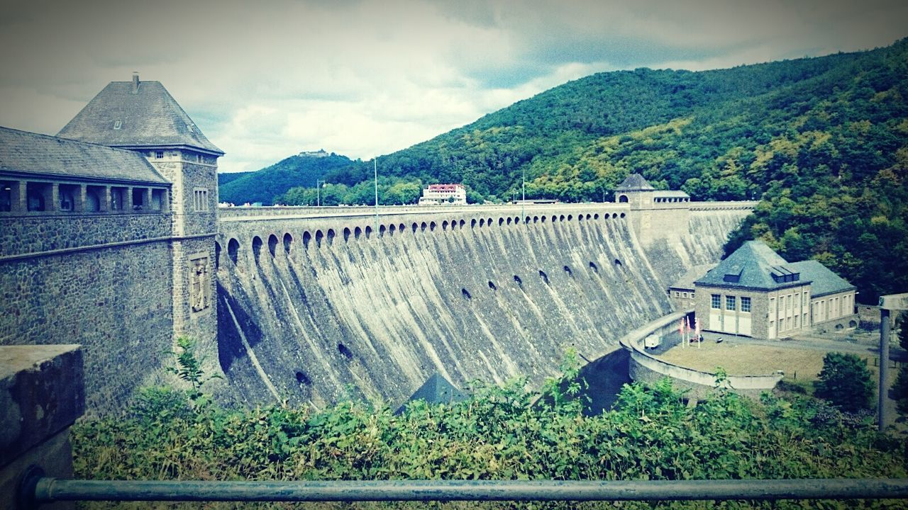 Dam By Tree Mountains Against Sky