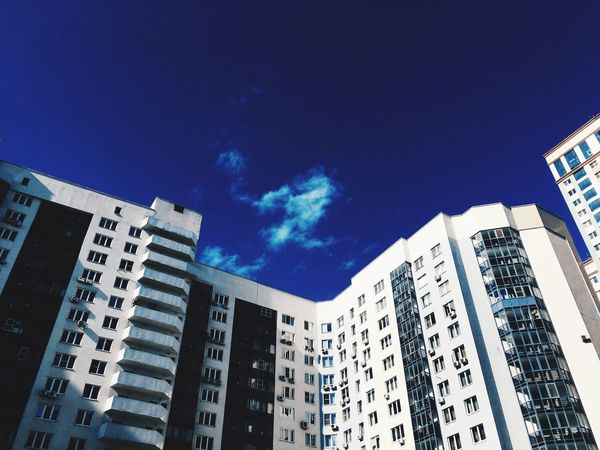 Low Angle View Architecture Building Exterior Built Structure Blue Window City Apartment Sky Skyscraper Residential Building No People Day Housing Development Outdoors Cityscape