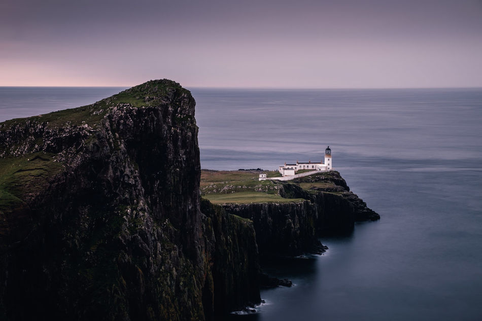 At the edge of the Isle Of Skye. Location: Neist Point, Scotland Equipment: Fujifilm X-T1 + XF18-55 Architecture Atmosphere Blue Building Exterior Cliff Evening Fuji History Isle Of Skye Landscape Landscape_Collection Lighthouse Mood Nature Neist Point Night No People Ocean Outdoor Outdoors Purple Schottland Sea Skye Water