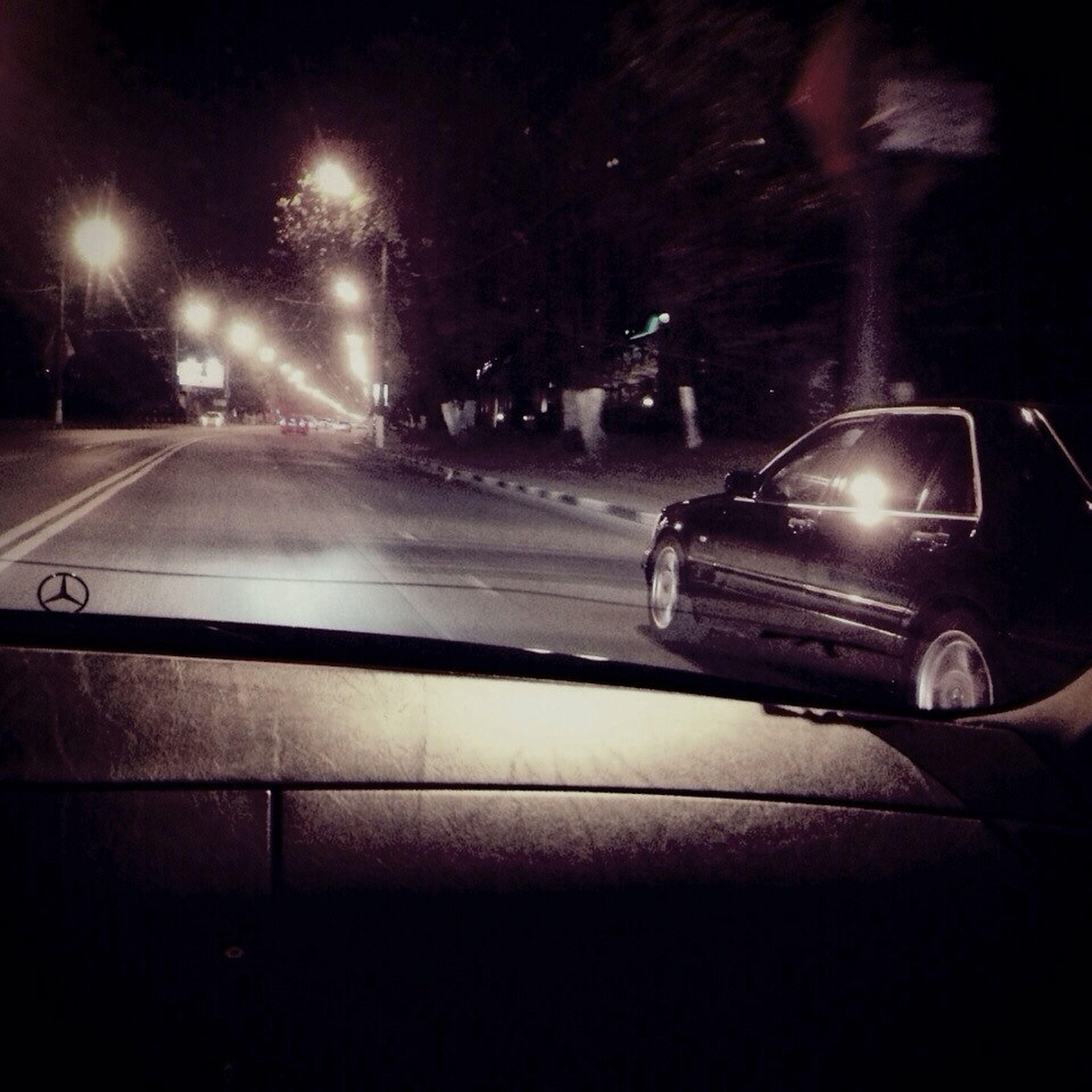 transportation, mode of transport, land vehicle, night, illuminated, car, road, travel, on the move, street, speed, headlight, motion, car interior, windshield, part of, vehicle interior, road marking
