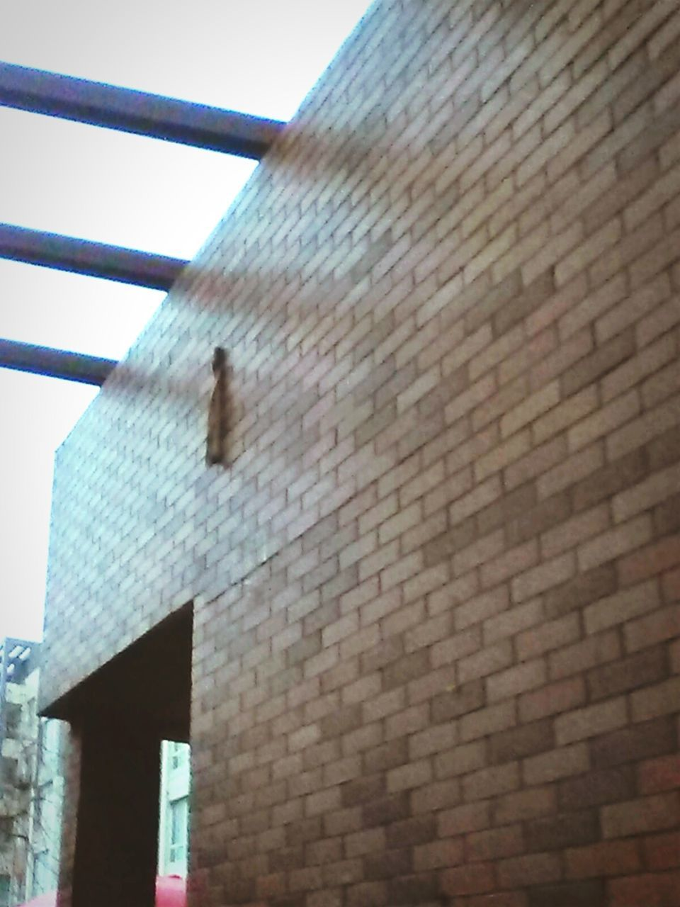 built structure, architecture, building exterior, low angle view, brick wall, day, outdoors, no people, sky, close-up