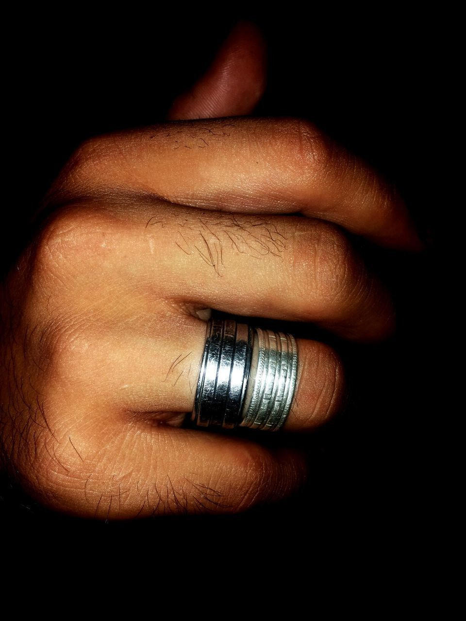 black background, studio shot, human body part, human hand, close-up, one person, indoors, adult, people