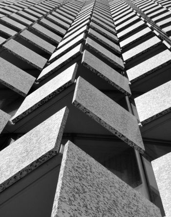 Low Angle View Architecture Tall - High Built Structure In A Row Repetition City Building Exterior Skyscraper Tall Day Outdoors Full Frame Surface Level Sky Architectural Feature Diminishing Perspective Office Building No People Contrasts