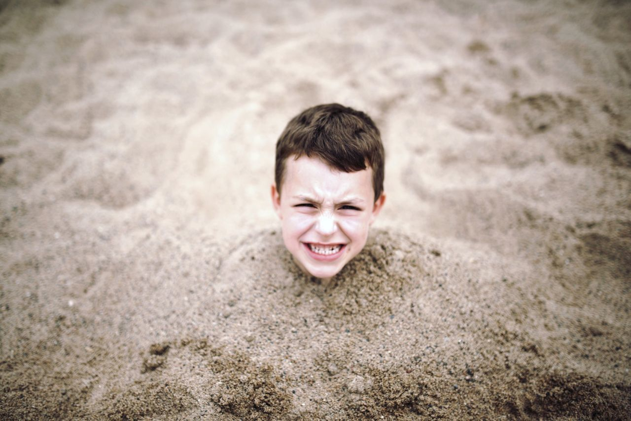 Beautiful stock photos of sand, Beach, Boys, Buried, Caucasian Ethnicity