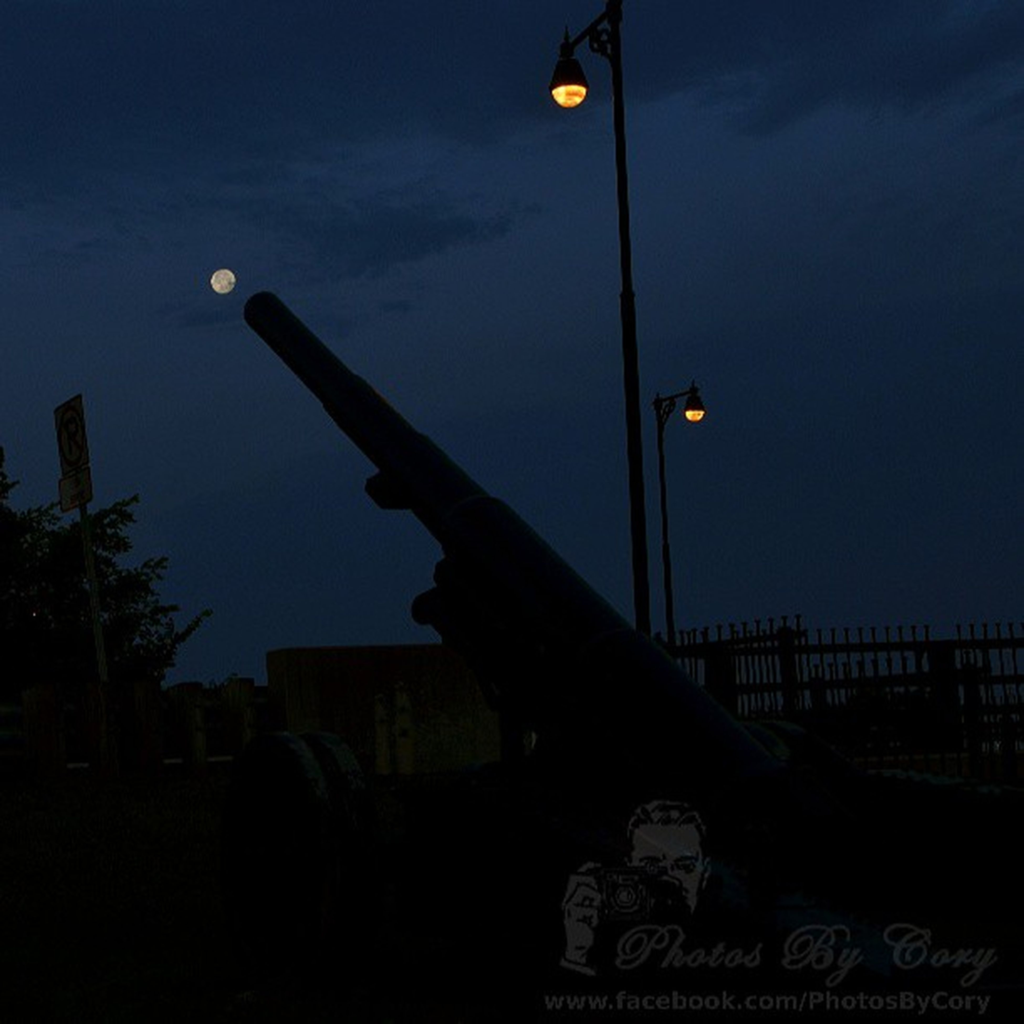 sky, street light, night, illuminated, low angle view, dusk, lighting equipment, silhouette, cloud - sky, transportation, one person, outdoors, moon, cloud, mid-air, built structure, pole, sunset, flying
