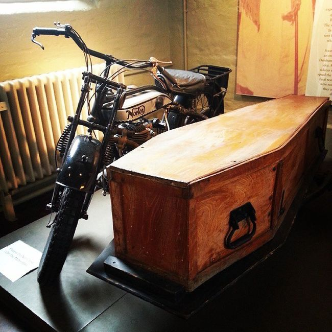 This unusual vehicle, made by a local undertaker, was used in the workhouse to transport the bodies of the inmates cheaply and quickly to the local graveyard once the workhouse graves were full. A very forward thinking and innovative invention at the time. Motorbike Motorcycle Coffin Workhouse vintage transport grave funeral unusual burial