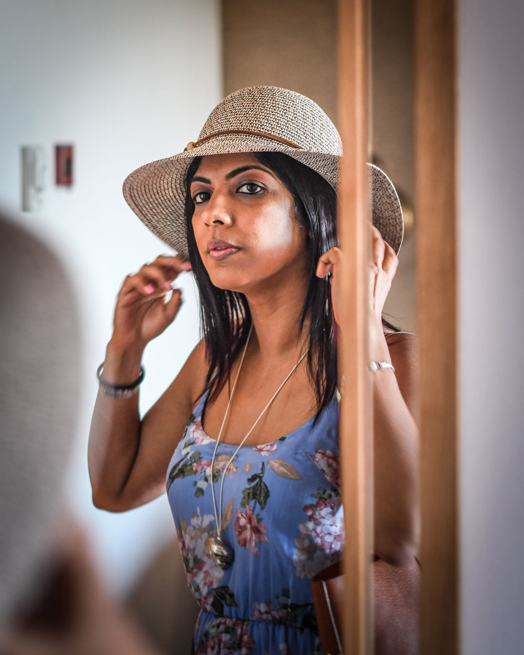 Reflection Of Woman On Mirror Getting Dressed