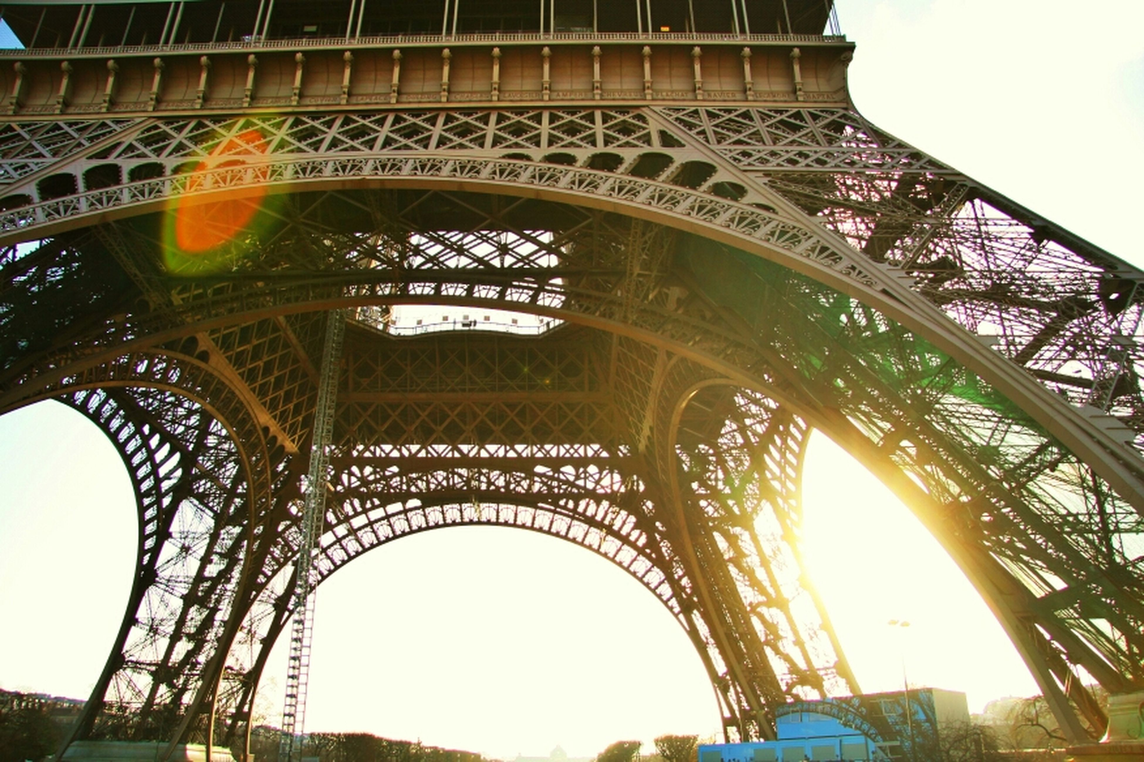 architecture, built structure, arch, low angle view, bridge - man made structure, connection, engineering, famous place, international landmark, travel destinations, tourism, architectural feature, metal, architectural column, bridge, arch bridge, history, sky, travel, capital cities