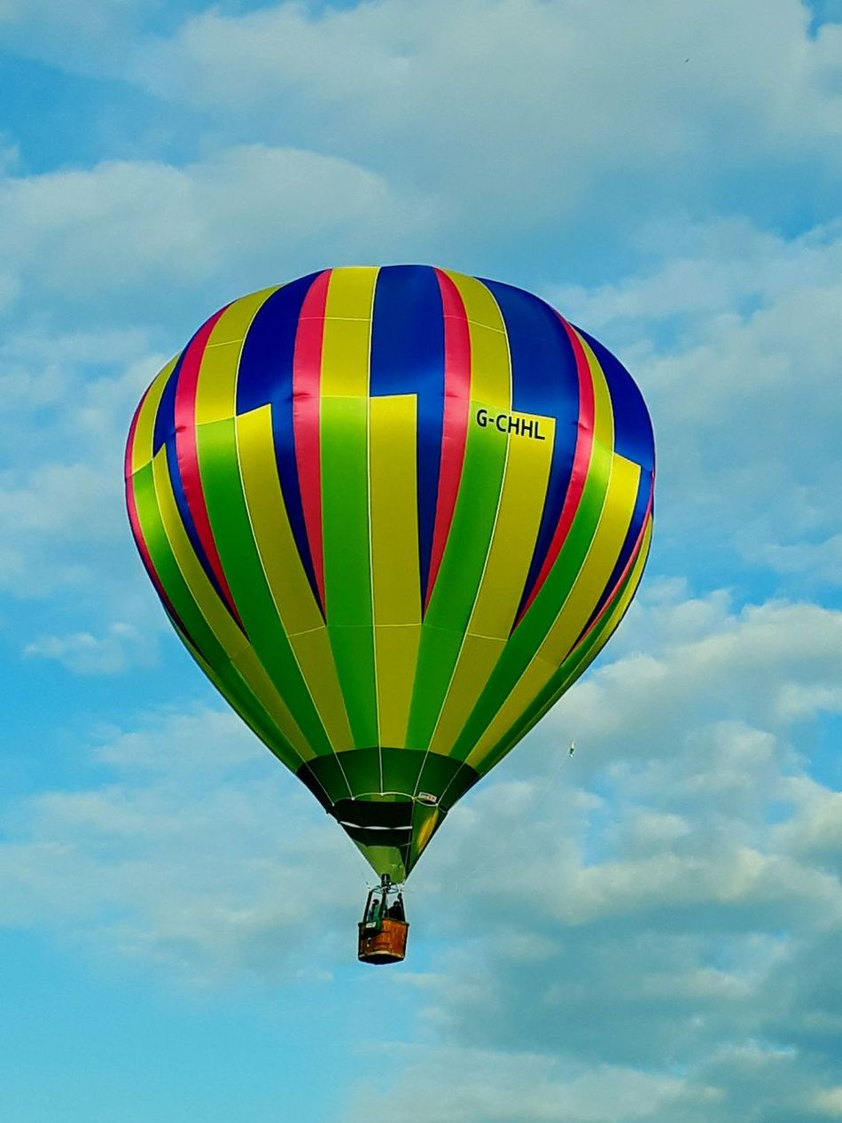 Hot air balloon on a sunny spring evening Hot Air Balloon Multi Colored Basket Flying Cloud - Sky Flame Adventure Helium Balloon Transportation Helium Mid-air Ballooning Festival Sky Air Vehicle Day Balloon Outdoors People First Eyeem Photo