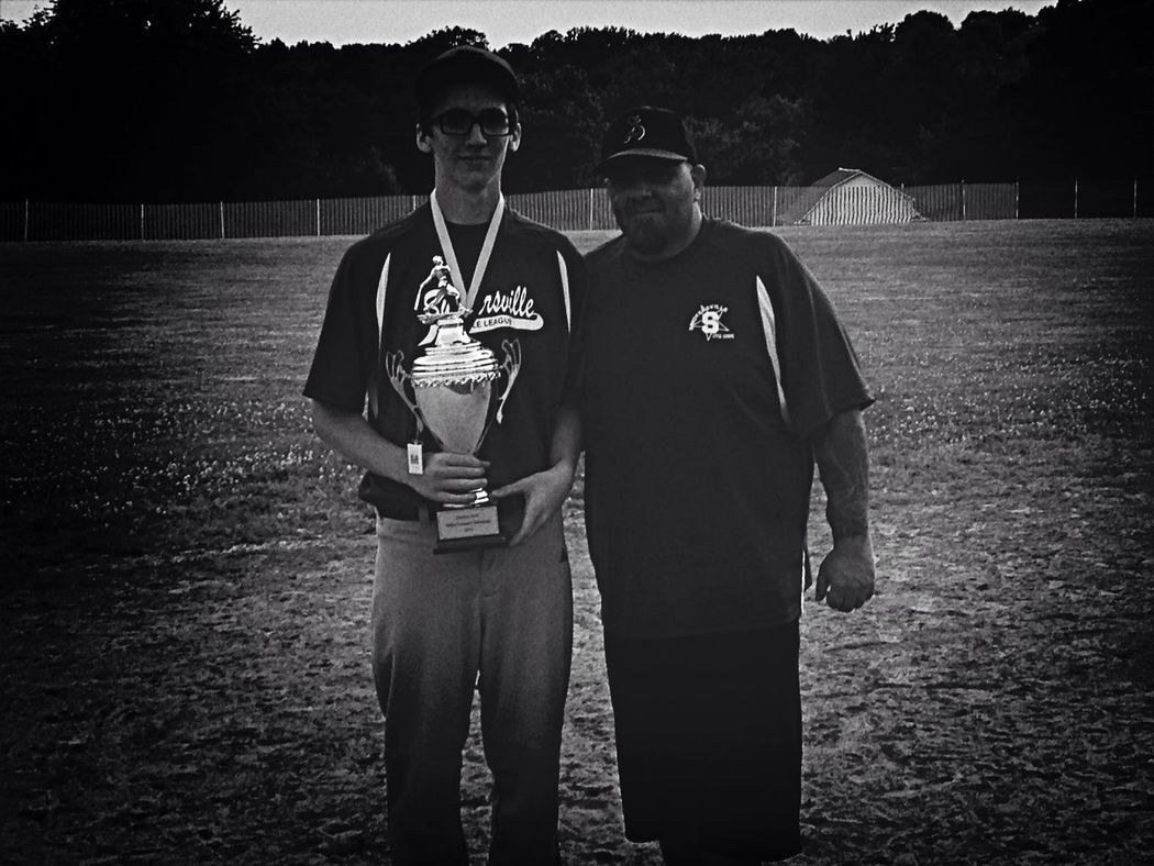 Black/white pic of my son & his baseball coach holding their trophy for winning the district championship! Great Memories Proudmom