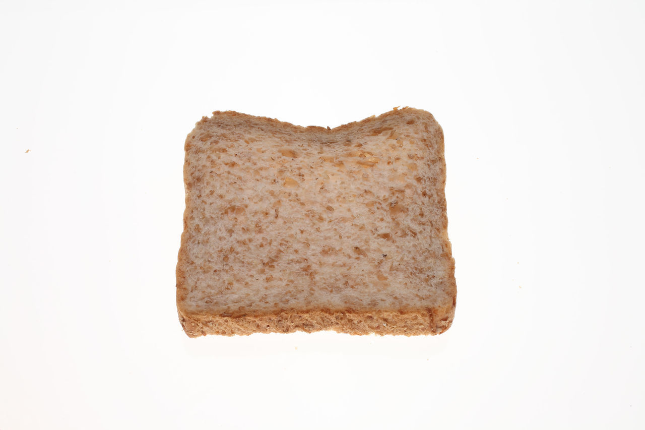 slices of Wholemeal toast bread on white Bread Brown Close-up Copy Space Cut Out Geometric Shape Homemade Indulgence Making No People Ready-to-eat Slices Studio Shot Symbol Temptation Toastbread Toast🍞 Unhealthy Eating White Background Wholemeal Wholemeal Bread