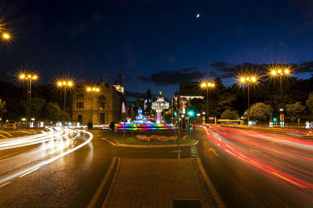 Architecture Building Exterior Built Structure Cibeles City Colorful Fountain Gay Pride Illuminated Light Trail Long Exposure Madrid World Pride Moon Motion Night Outdoors Pride Road Sky Speed Street Street Light Transportation