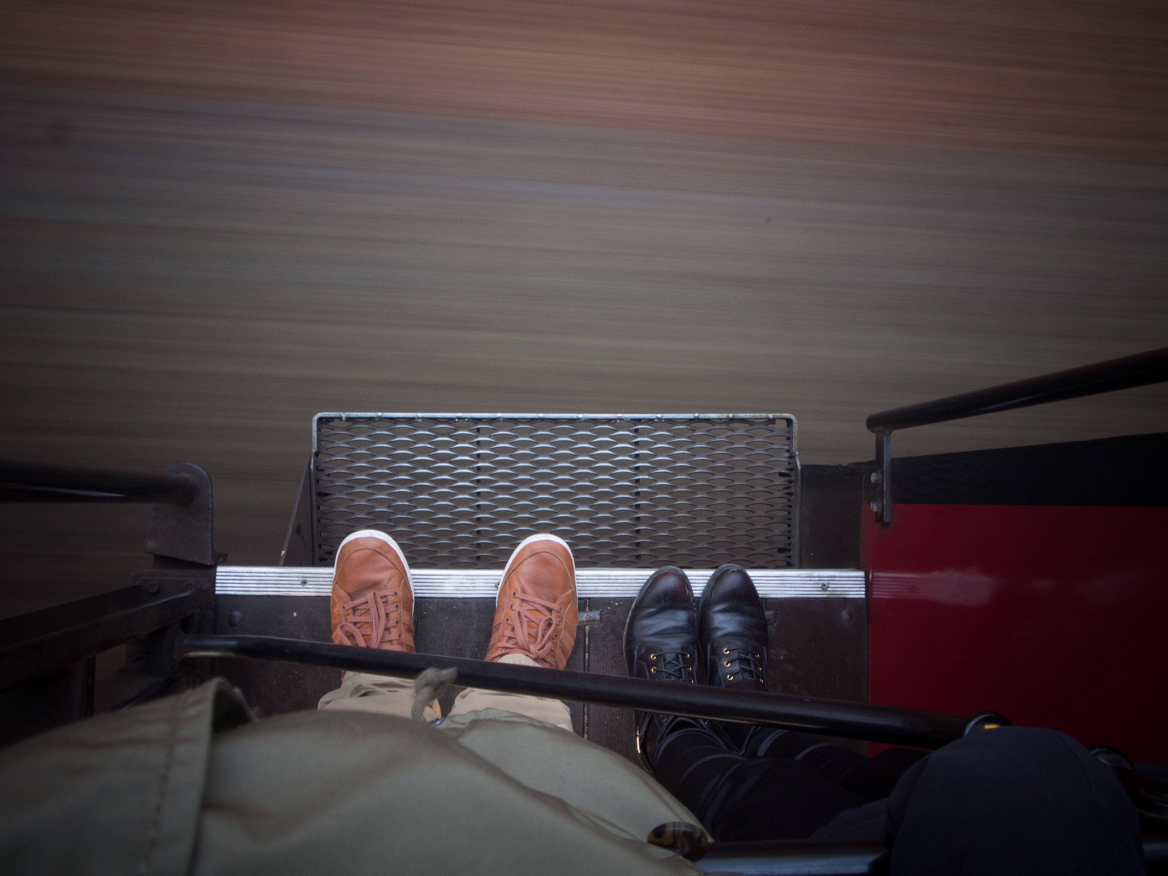 indoors, shoe, low section, men, high angle view, person, sitting, transportation, standing, lifestyles, mode of transport, day, personal perspective, chair, relaxation, footwear
