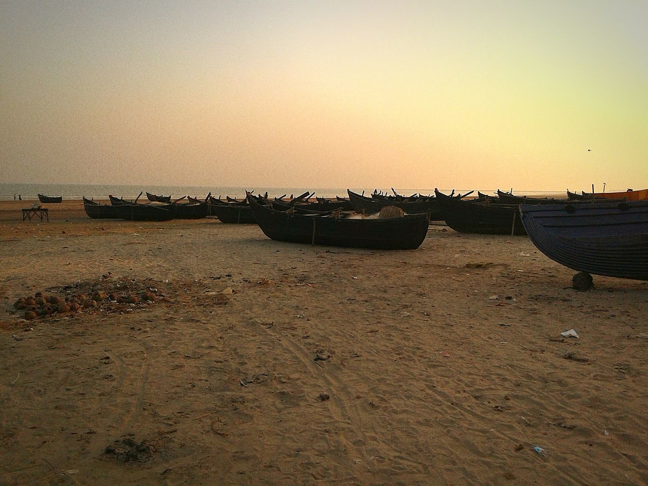 nautical vessel, boat, beach, transportation, water, moored, shore, nature, mode of transport, sunset, sand, scenics, sea, beauty in nature, clear sky, tranquility, horizon over water, sky, tranquil scene, no people, outdoors, longtail boat, day