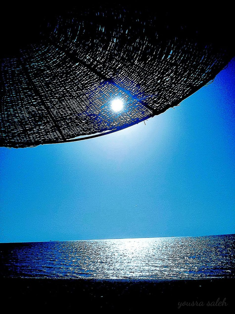 Blue Wave Sun Sunlight Sea Blue Sea Blue Sea And Blue Sky Sky Pure Sky Blue Sky Sunlight Through Beach Umbrella Beach Umbrella Beach Nature Photography Nature_collection Naturelovers Nature Tranquil Scene Sun Reflection Relaxing View Relaxing Summer Memories Beatiful Nature Romanticism Of Nature❤ Ras Sudr Egypt Love To Take Photos ❤