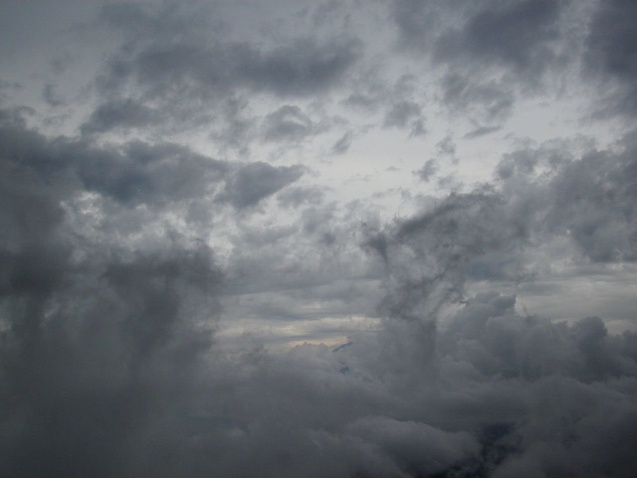 cloud - sky, beauty in nature, nature, weather, cloudscape, sky, atmospheric mood, scenics, sky only, tranquility, backgrounds, low angle view, no people, tranquil scene, storm cloud, full frame, storm, day, outdoors