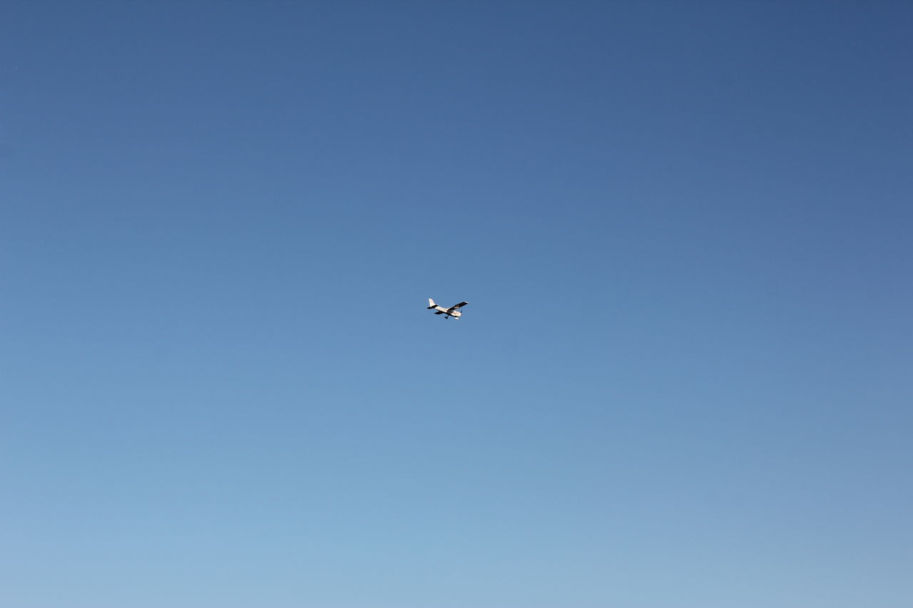 Light Aircraft in the Sky Air Vehicle Airplane Blue Camera - Photographic Equipment Clear Sky Day Drone  Flying Kleinflugzeug Light Aircraft Lightplane Low Angle View Media Equipment Mid-air Nature No People Outdoors Photography Themes Puddle Jumper Sky Small Plane Technology