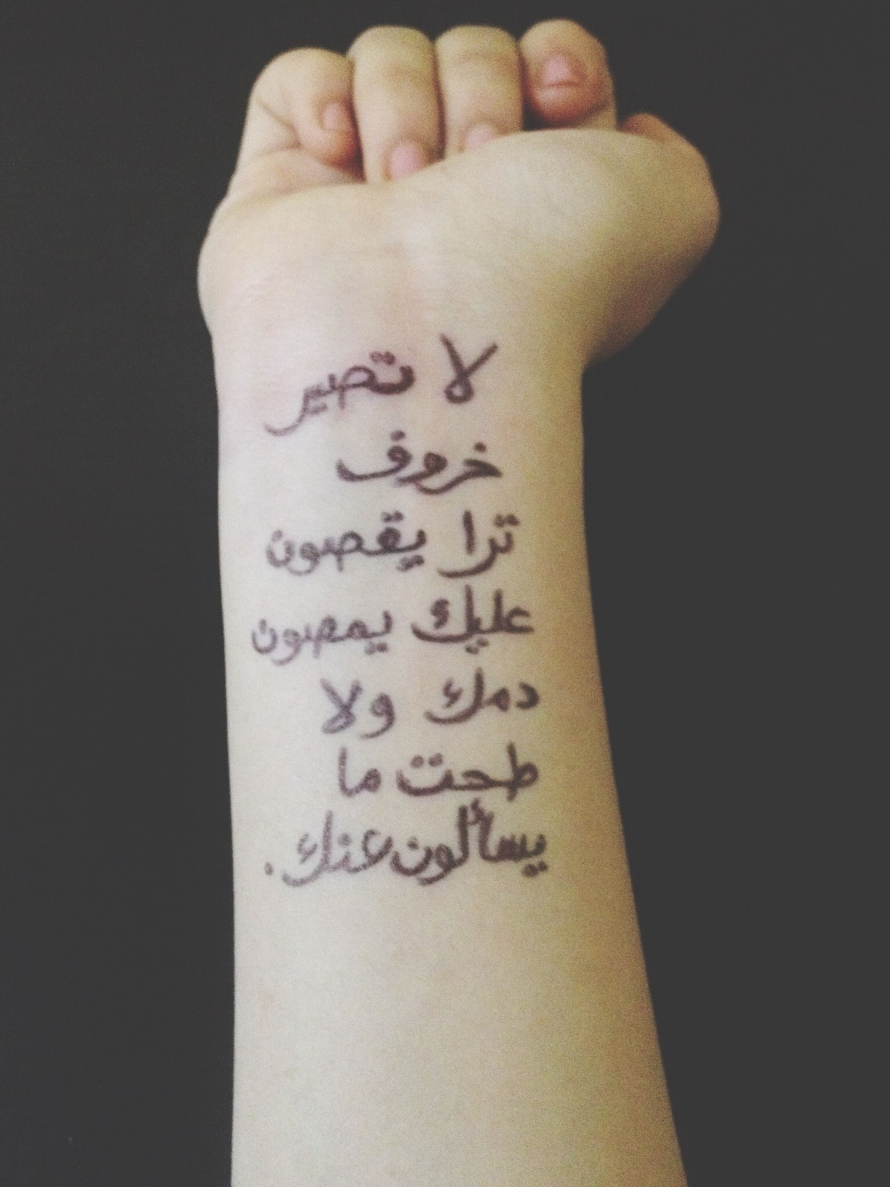 text, western script, person, communication, indoors, part of, close-up, studio shot, human finger, cropped, paper, black background, non-western script, number, holding, handwriting, message