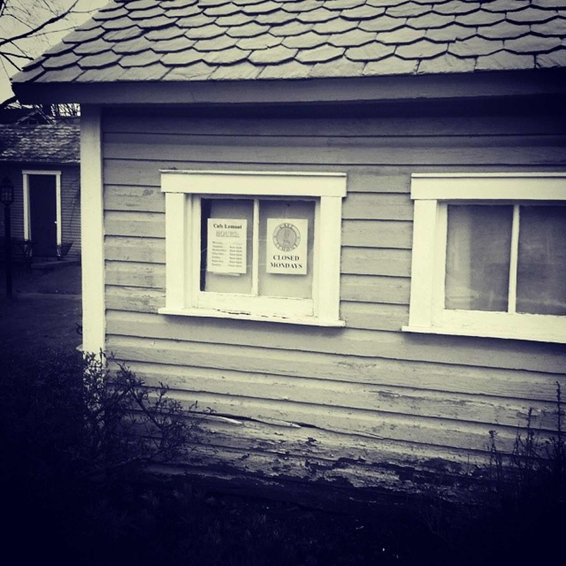 Closed Mondays Coffeehouse Lamonthouse Happyvalley Blackandwhite aviary clapboard chipped paint ruraldecay bushes