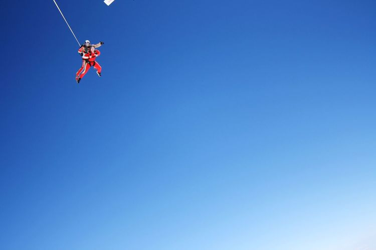 Blue Clear Sky Low Angle View Real People Flying Men Extreme Sports Plane Let's Go. Together.