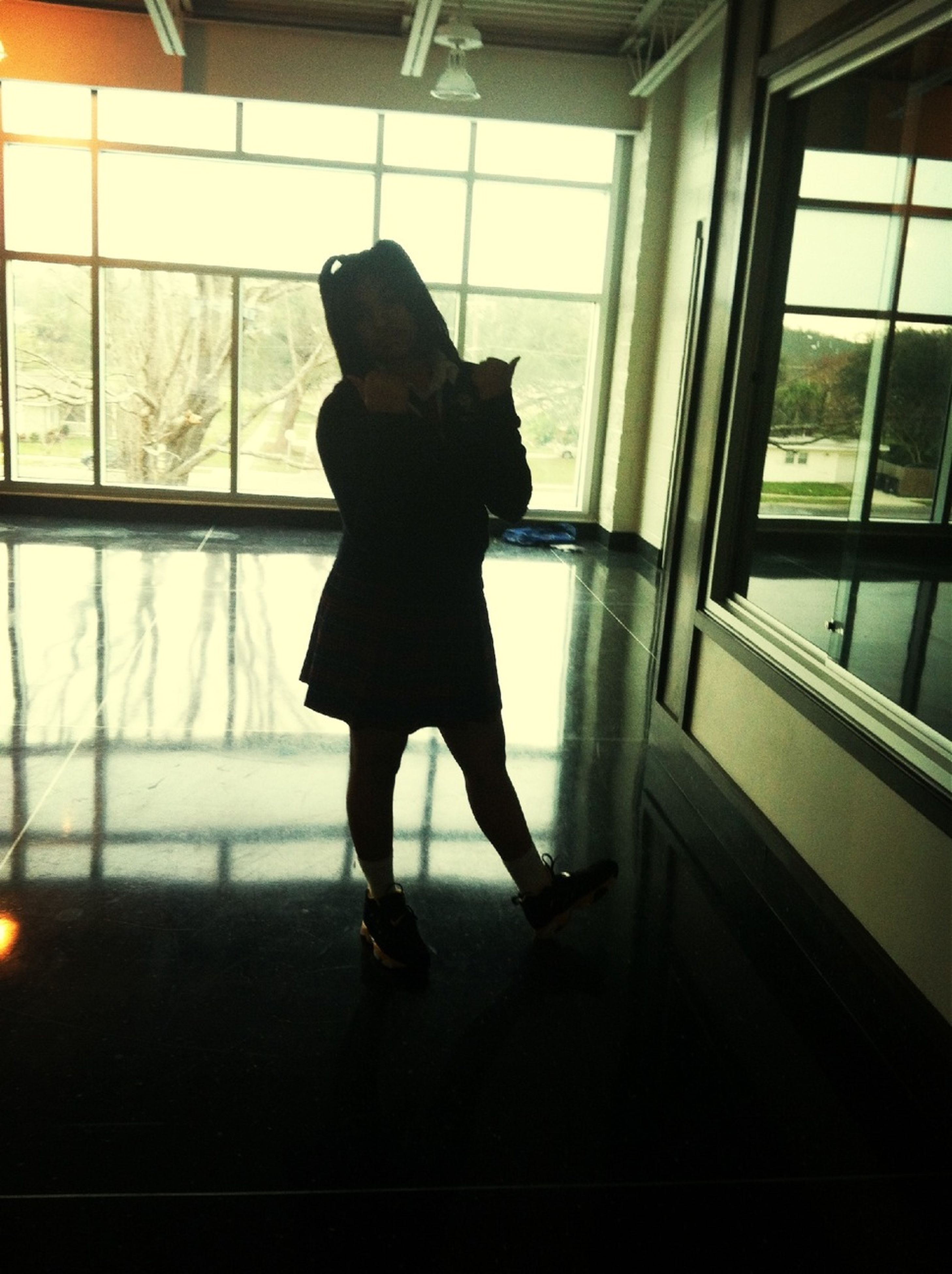 indoors, window, full length, glass - material, transparent, men, silhouette, lifestyles, rear view, standing, person, looking through window, side view, leisure activity, sitting, day, reflection, sunlight