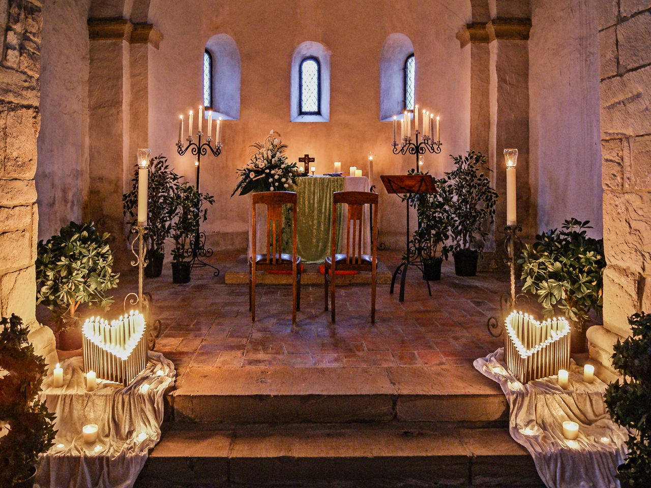 illuminated, candle, table, indoors, religion, no people, statue, architecture, flower, day