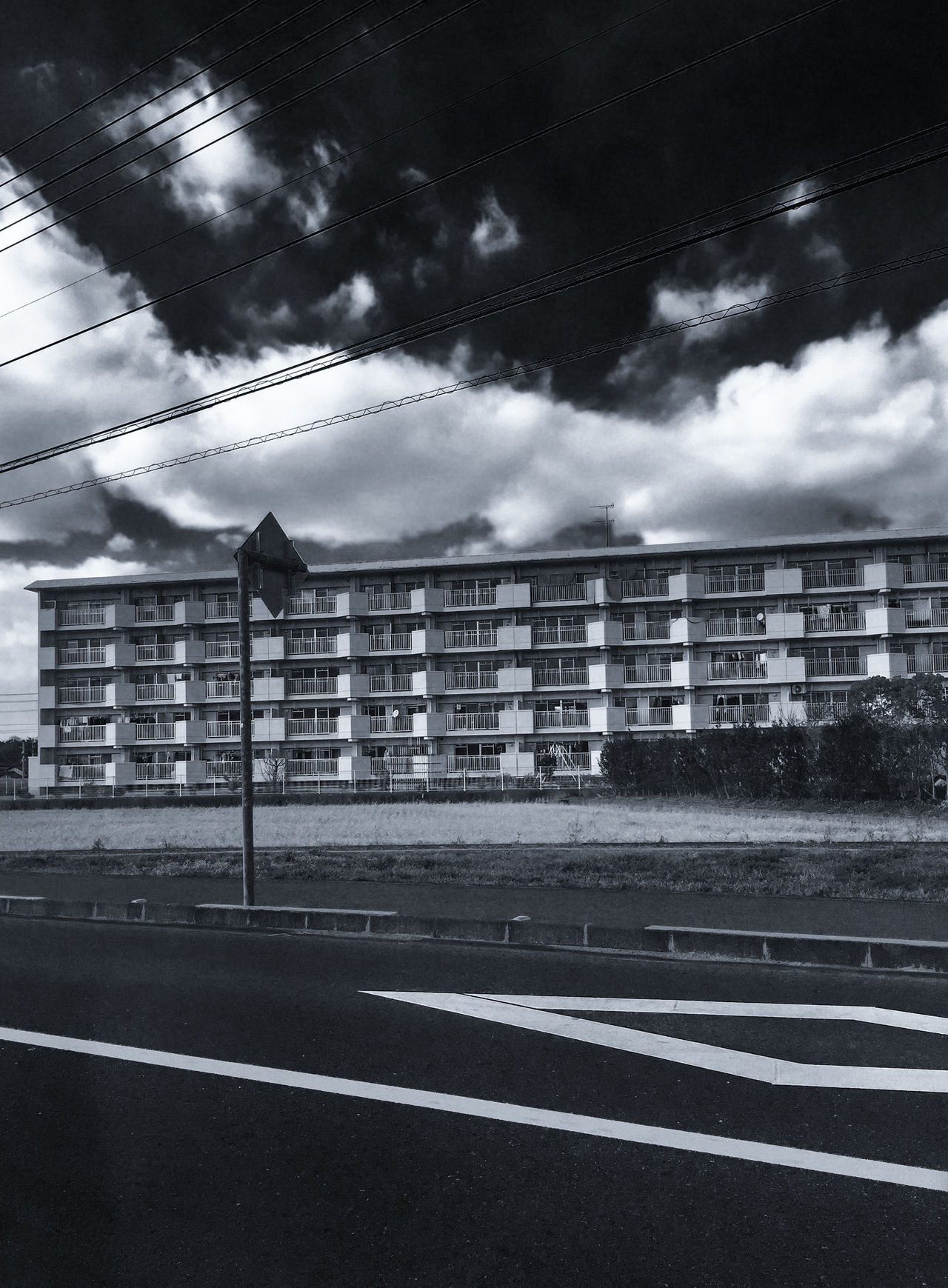 // dark bright // Architecture Blackandwhite Bnw Bnw_captures Bnw_collection Building Building Exterior Built Structure BYOPaper! City Cloud - Sky Clouds And Sky Day Empty Road Japan Monochrome No People Outdoors Road Signboard Sky The Architect - 2017 EyeEm Awards The Street Photographer - 2017 EyeEm Awards Tranquility Ultimate Japan