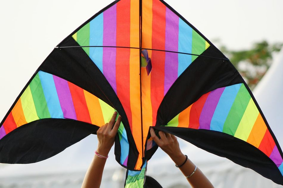 Multi Colored Wind Outdoors Day Sky Ballooning Festival Kite Kitefestival Kite - Toy Outdoor Activities Outdoor Games Springtime Human Body Part Human Hands