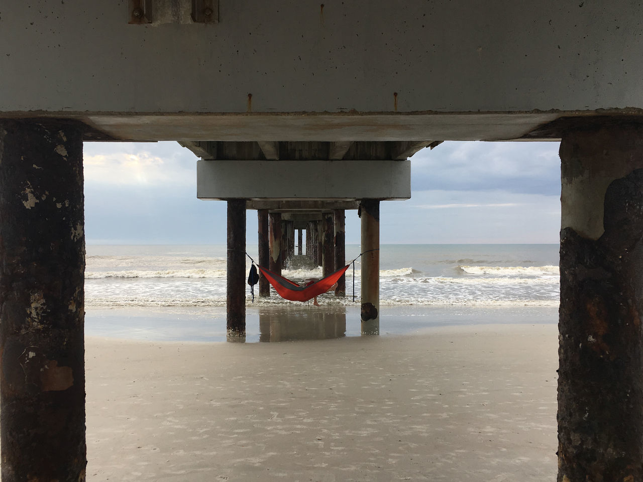 Napping under pier Architecture Beach Beauty In Nature Day Hammock Horizon Over Water Nature No People Outdoors Sand Scenics Sea Sky Tranquil Scene Underneath Water