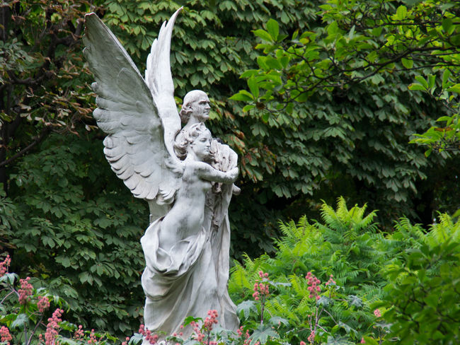 Angels Day France Green Color Human Representation Jardin Du Luxembourg Marble Mythology No People Outdoors Paris Park - Man Made Space Plant Sculpture Statue Stone Material Tranquility White Color