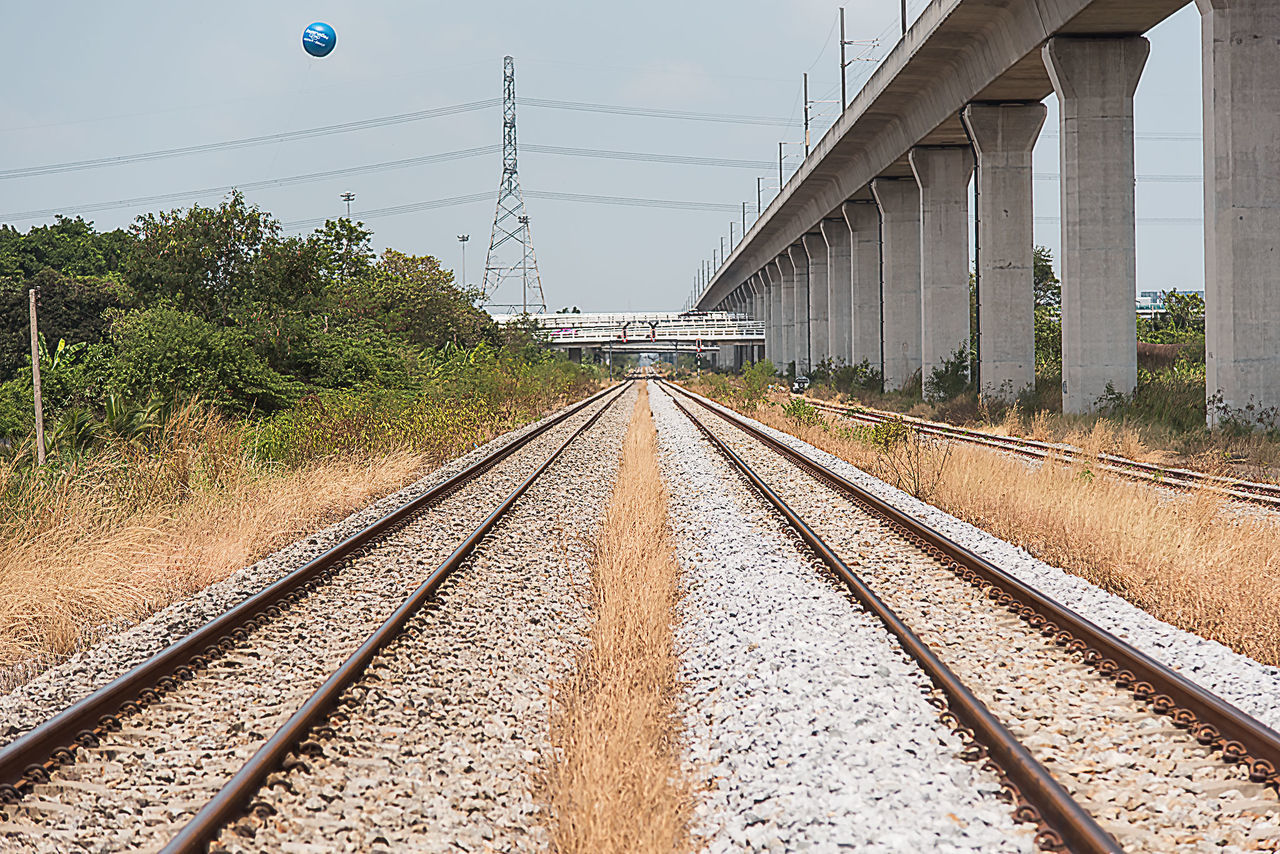 railroad track, rail transportation, transportation, day, no people, connection, the way forward, outdoors, architecture, built structure, sky, tree