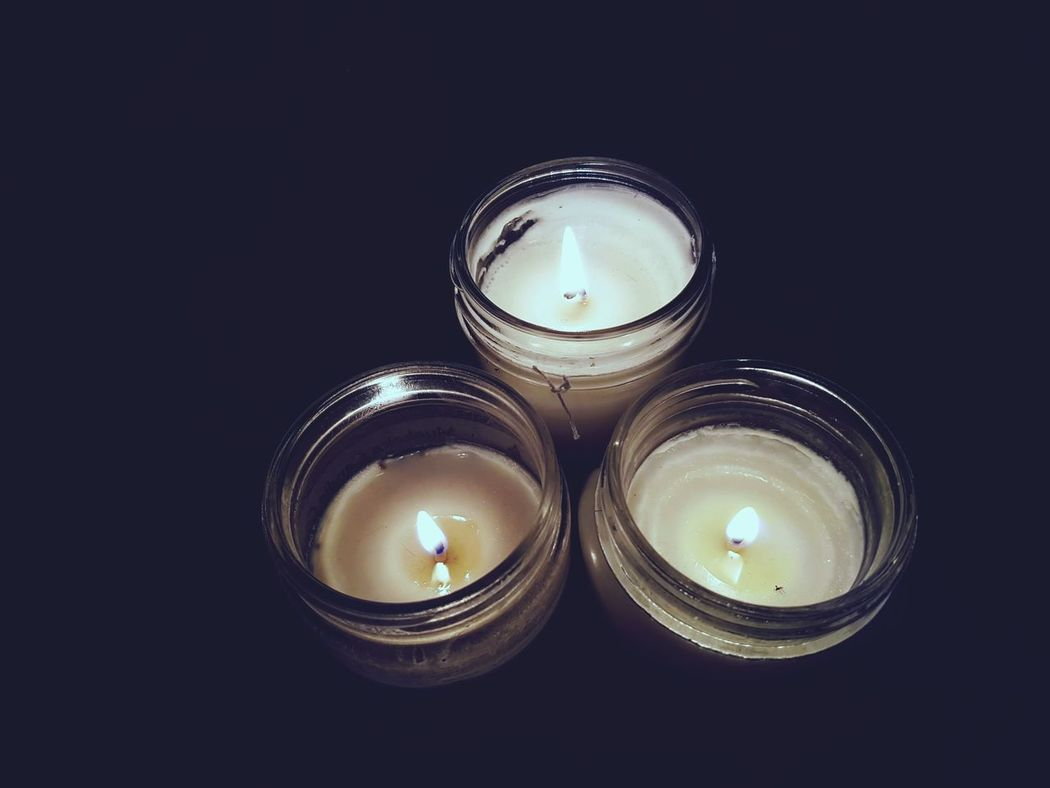 Earth Hour... Candle Flame Burning No People Illuminated Heat - Temperature Candlelight Indoors  Close-up Three Candles Glass Candle Holder Lit Flame Mobile Photography EyeEmBestPics Eyeem Collection Eyeem Marketplace Night Time Reflection Wax Cream Coloured Art Is Everywhere