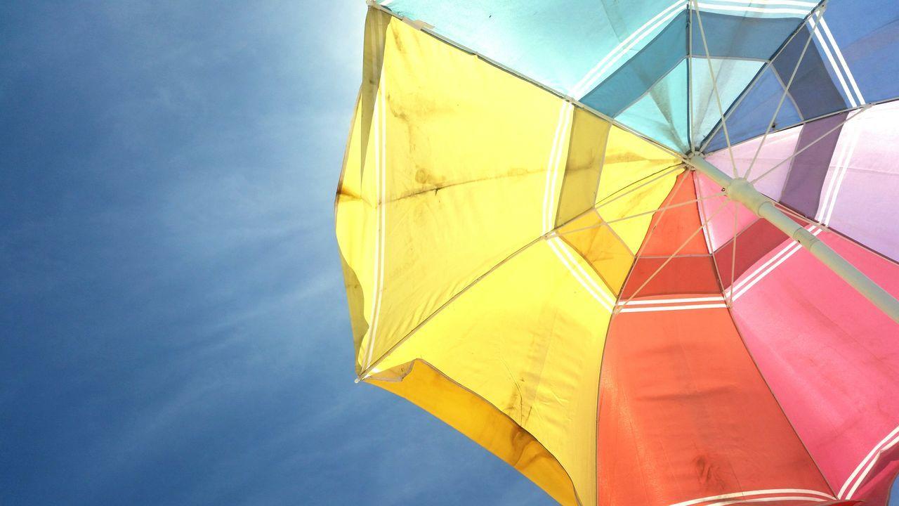 The Essence Of Summer Beachphotography Beach Photography Umbrella Sky Sky Umbrella Beachumbrella Beach Umbrella